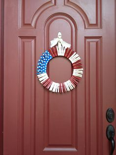 Steal supplies from your laundry to make this unique take on the American flag. Click through to find out how to make this DIY Fourth of July wreath and other Fourth of July crafts.