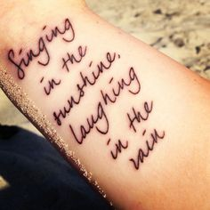 "My first tattoo :) ""Singing in the sunshine, laughing in the rain"""