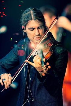 Love this pic ♥ Jenn, and all of my beautiful David loving fans......this is my fav pic of David. I love that he is concentrating on playing. I love his facial expression. I love what he is wearing. His hair looks perfect and love how his hair is falling down in his face. I love the way he is holding his hands. I love the orbs of light in front of him! Shall I go on?! xox