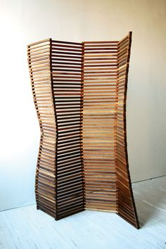 Cool room divider.  Would be time consuming, but think I could make this a pretty cool DIY.