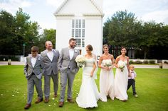 Groomsmen in gray suits and bridesmaids in pale pink dresses leave church with the bride and groom. | Sarah Lyn Photography | http://www.mywedding.com/articles/rebecca-johns-traditional-seaside-fl-wedding-by-sarah-lyn-photography/