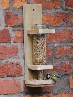 Wine bottle bird feeder, great way to recycle those bottles! Gardening, DIY