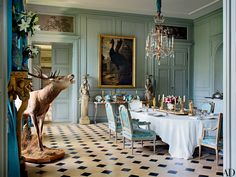 Château de Digoine, French Filmmaker Jean-Louis Remilleux's Antique-Filled Chateau. The north dining room is furnished with an Italian chandelier, a Francis Barlow painting of a cassowary, and Louis XVI chairs. Pink Dining Rooms, Luxury Dining Room, Dining Room Design, Aqua Rooms, Green Painted Rooms, Blue Green Rooms, Architectural Digest, French Interior, Classic Interior