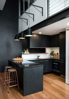 Minimalist gothic small open kitchen black painted cabinetry gloss and black bar table copper toned bar Open Plan Kitchen Living Room, Kitchen Design Open, Open Concept Kitchen, Kitchen Designs, Kitchen Ideas, Small Open Kitchens, Black Kitchens, Black Kitchen Island, Kitchen Exhaust