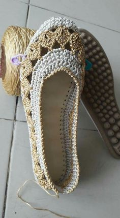 Me: I love the lace crochet around this slipper.Also the natural colors are calming.