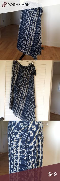 """NWOT, Ralph Lauren linen-silk high-low skirt. NWOT Ralph Lauren high-low, silk-linen skirt with side knot closure. Blue and ivory ikat-tribal pattern. Left side is 33"""" long with lots of draped fabric and a slit. Length of the rest is 29"""". Ralph Lauren Skirts Asymmetrical"""