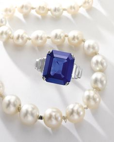 9.93 carats Kashmir step-cut sapphire and diamond ring