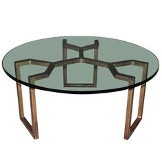 View this item and discover similar for sale at - Elegant round gilt wrought iron coffee table. Table legs have a distinctive geometrical crab style form and a lovely natural patina. Model of Jean Royere.