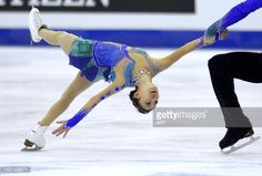 China's Qing Pang and Jian Tong perform in the pairs free program during the 2012 World Figure Skating Championships on March 30, 2012 in Nice, southeastern France. AFP PHOTO / SEBASTIEN NOGIER (Photo credit should read SEBASTIEN NOGIER/AFP/Getty Images)