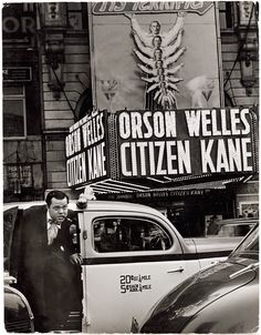 """Orson Welles stepping out of taxi in front of Palace Theater with neon lights spelling out """"Orson Welles Citizen Kane,"""" New York City, 1941 #vintagephotos #orsonwelles"""