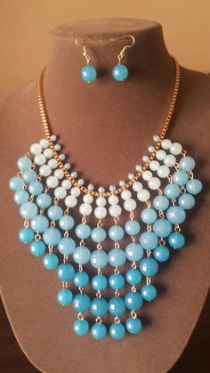 Last chance for FREE SHIPPING!!!  https://www.etsy.com/listing/211983116/blue-and-gold-bib-necklace-set-collar