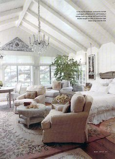 I love the layered rugs, vaulted white painted ceiling and of course the windows/view.