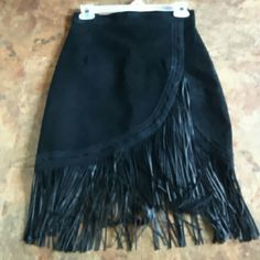 SUEDE BLACK SEXY FRINGE SKIRT..NWT Black suede skirt with fringes at the bottom..zip up in the back.. Brand new..was too small for me...Remember FRINGE is IN!!! Great with heels or boots!! Skirts High Low