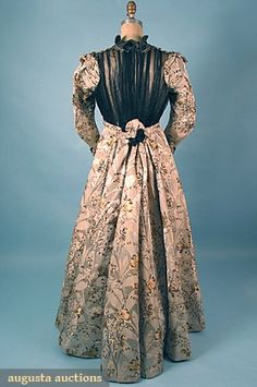 "SILK AFTERNOON DRESS, c. 1898 2-piece taupe faille & silver satin figured dress brocaded w/ gold & black floral sprays, bodice w/ elaborate beaded & lace applique trim & pleated black silk chiffon, label, ""E.E. Chapman Roxbury"""
