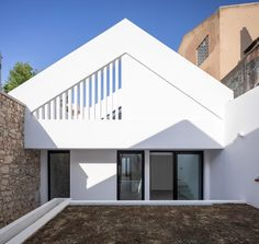 Architects André Caetano and Ana Fiúza have converted a former sawmill in the Portuguese town of Oeiras into a house that stands behind a freestanding gabled wall. Portugal, Narrow House, Gable Roof, Ground Floor Plan, Urban Planning, Second Floor, Facade, Stairs, Floor Plans