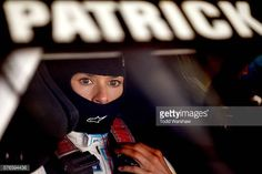 Danica Patrick driver of the Nature's Bakery Chevrolet sits in her car during practice for the NASCAR Sprint Cup Series New Hampshire 301 at New...