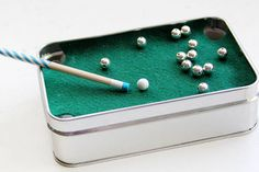 Not everyone wants to go all the way to the bar for a quick game of pool, so create your own mini travel tin — pool game included. Get the tutorial at Crafts Unleashed »  - GoodHousekeeping.com