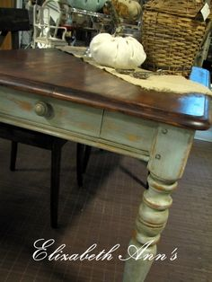 Farm table - top was sanded and re-stained dark and legs painted with a mixture of ASCP Duck Egg & Louise Blue.