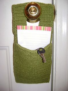 """Hang this useful organizer from a door knob to keep all kinds of small items handy. Measures approx. 5"""" x 10"""" (12.5 x 25.5 cm). Shown in Patons Classic Wool #207 Rich Red, using 5 mm (U.S. H or 8) crochet hook. (Patons Yarns)"""