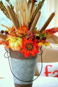 Fall Container: Get a metal container, and add some twine, then add seasonal flowers, leaves, gourds. Finish with raffia or a bow