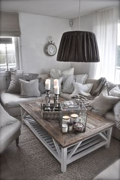 Love the natural grey tones and the comfort of this room