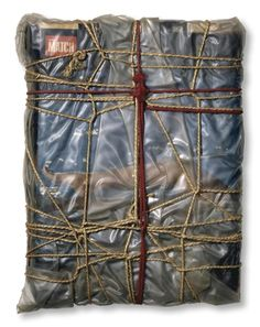 "amalgammaray:  Christo  Wrapped Magazines   1962  15 x 12 x 2"" (38 x 30 x 5 cm)  Polyethelene, rope, cord and magazines  Photo: Christian Baur  © 1962 Christo"
