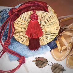 Who doesn't want to tote around a little piece of Rio de Janeiro?PetitBalaio Bag now Available at Round Straw Bag, Round Bag, Types Of Purses, Sisal, Paper Weaving, Basket Bag, Trendy Accessories, Knitted Bags, Basket Weaving