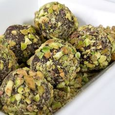 Chocolate Pistachio Coated Truffles 8 ounces good-quality semisweet chocolate, chopped ½ cup heavy cream 2 tablespoons vanilla extract or flavoring Pistachios, chopped