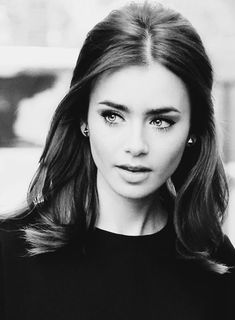 Lilly Collins. Her make up is beautiful. There is something in this photo that reminds me of Audrey Hepburn! Beautiful