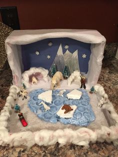 Bubble painted for the water. Bear den made from clay and covered with fake snow