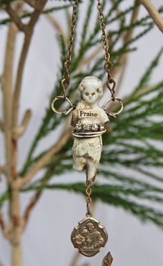 PRAISE Frozen Charlotte GUARDIAN ANGEL with by jeanettejanson.. I love the wire wings on her and how they are used to hang from the chain....