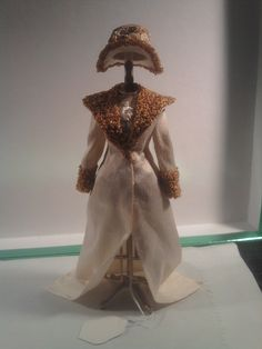 Coat and hat in an Edwardian style. Nice use of unravelled Bunka for coat trim and lapels. Link is broken but these may have been made by Felma