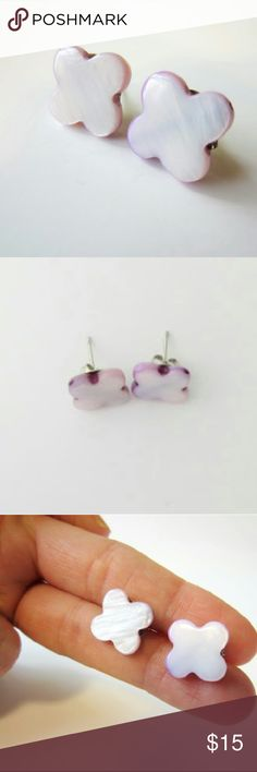 Purple Clover Stud Earrings It's your lucky day! These purple clover studs with the appearance of mother of pearl are in excellent condition!  -Excellent used condition, one minor scratch (looks like it's part of the design) -Light purple color -2 cm in diameter   Questions? Just ask! Bundle to save! Offers welcome Happy Poshing! Jewelry Earrings
