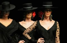 Models present creations by Spanish designer Pilar Vera during the 2011 International Flamenco Fashion Exhibition on Wednesday in Seville.
