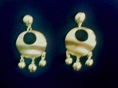 Brincos Saturno. Catálogo MAOSECRETS. http://www.maosecrets.com.br