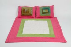 Handwoven Cotton Faat Kids Quilt by WMD. $119.99. Kids Quilt. Made in India. 100% Cotton. White/Pink/Green Combination. The hand woven quilt features a simple and yet colorful girly them. Perfect for your little princess. Great combination of rich cotton and hand-woven process. Three colors of White / Green / Pink with 2 pillow covers (Toddler Size) - Hand Stitched and inspired by natural designs - Quilt is embroidered and appliquéd - Quilted in small villages of India - Sh...