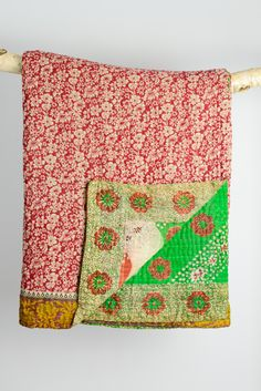Handmade kantha quilt from vintage saris. These support a project for trafficked women in Bangladesh.