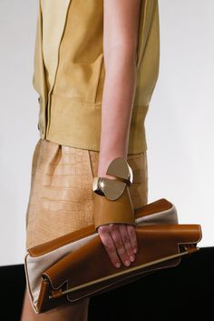 """""""Hermès - Detailles S/S 2013"""" envelope roll+on leather and canvas clutch"""