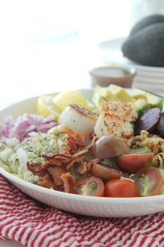 Seared Scallop Cobb Salad via JennySheaRawn.com. Lightly seared scallops sit atop a bed of crisp iceberg lettuce, along with creamy avocado, pungent blue cheese, crunchy walnuts, crispy bacon, fresh garden tomatoes, earthy beets and sweet red onion. This is a seafood lovers cobb. @JennySheaRawn