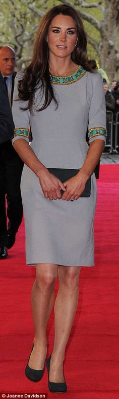 Kate wore a grey Matthew Williamson dress with subtle peplum detail and jade green beading trim
