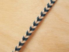 The method for making this braid is exactly the same as Version 1, apart from the initial strand arrangement.   This braid uses 8 strands  – 4 each of two colors. This example was made with standard embroidery floss. Cut your strands 30% longer than your intended finished braid length if you're using embroidery floss, Read More