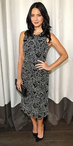 Olivia Munn looking very fashionable (and covered, if you know what I mean!)...