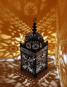 A traditional Moroccan lantern in both shape and finish. The metal of the side and dome panels has been hand carved and formed so that each part of the pattern is raised to give a three-dimensional effect.