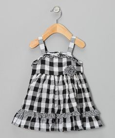 Boasting+a+rosette+flower+and+ruffled+hem,+this+breezy+dress+offers+an+adorable+way+to+stay+cool.+Back+buttons+make+it+easy+to+get+on+and+off,+while+the+tie+ensures+a+perfect+fit.