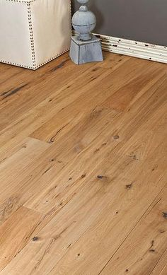 Pangaea Interior Design shows light wood flooring