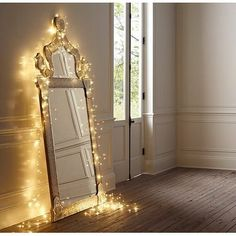 Twinkly lights around cool shaped mirror!  The girls will love this!