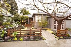 Zen Living  After: A rock wall with a water feature and a fence built using Japanese joinery methods help give an Asian Zen theme to the space. The former sunroom was also ripped out to create a larger porch area.