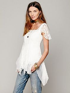 On A Whim Lace Top   Pieced together sheer chiffon and lace top. Bottom hem are of different lengths. Sleeves are short and sheer lace. Boxy neckline in front. Lined with sheer chiffon.