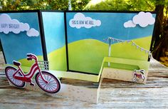 With a bow on top: Bike Ride Z-Fold Slider card for AddINKtive Designs Team