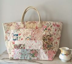 HenHouse Flea Market bag: This link does not go to the bag and the blog does not have a search box. Frustrating.